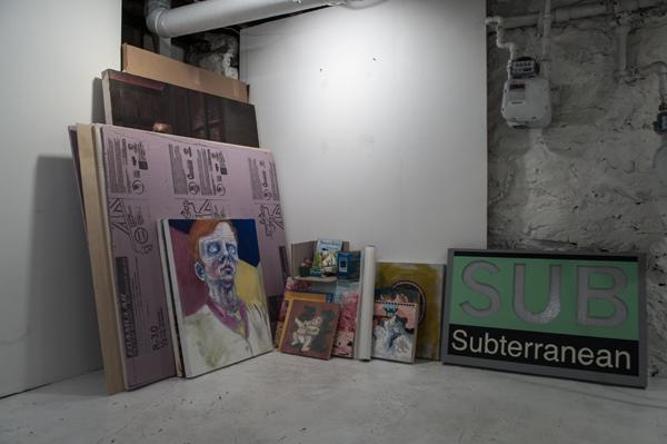Paintings are stacked in a corner of the Subterranean Gallery space as Rexroth and Skidmore prepare to move to New York.