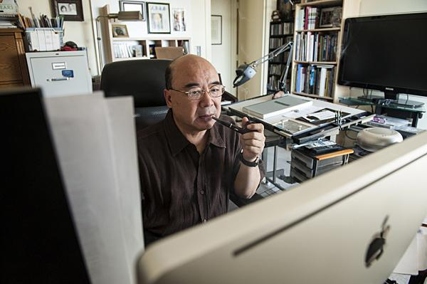 Zhou works on an opera in his home studio.