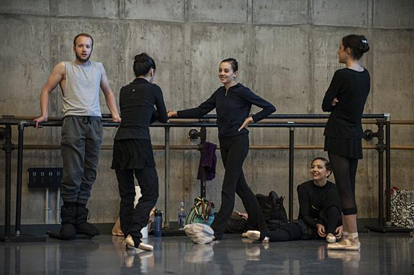 Craig Hall, (from left) Sarah Chun, Sarah Walborn, Arielle Espie,and Caroline Arnold warm up before the rehearsal.