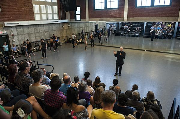 Addressing the crowd, Devon Carney, Artistic Director of the Kansas City Ballet, welcomes First Friday visitors to the company's open rehearsal.