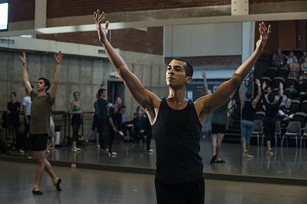 Touched by late afternoon light, Michael Davis dances with other company members for the Friday audience.