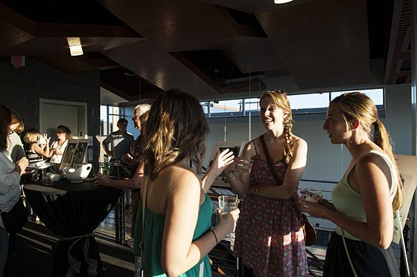 Enjoying drinks and conversation, Monica Hatch, (from left) Sarah McKee and Molly Troop chat in the waning sunset.