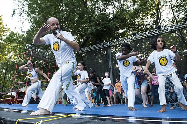 Eric Aggson, of Grupo Axé Capoeira, kicks off the dance festival with a lesson in a Brazillian martial art form.