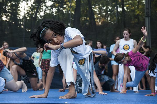 Verena Im, 8, of Grupo Axé Capoeira, moves to an Afro-Brazilian beat during a lesson before the festival.