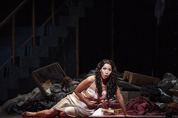 Asking her father for forgiveness after taking a potion, Nicole Cabell, as Giulietta, gasps and faints in the rubble of the Capulet garrison.