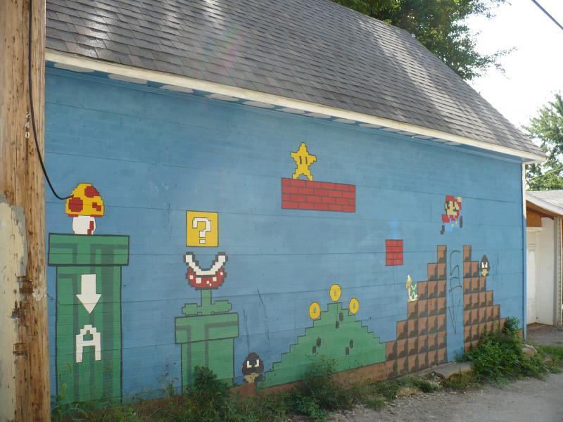 Art Squad member Amber Finley painted a Mario Bros. type mural on the alley across the street from the Community Garden.