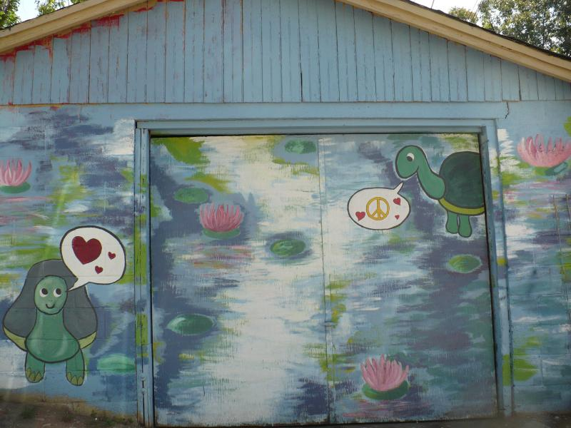 Art Squad member Marie Abed painted this Monet type landscape on her neighbor's garage.