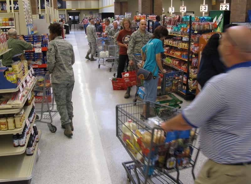 Shoppers packed U.S. military commissaries, like this one at Whiteman AFB on Tuesday. The government shutdown closed the stores indefinitely as of Tuesday night.