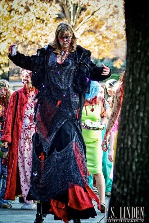 Turner leads a pack of zombies at the annual Kansas City Zombie Walk for charity.