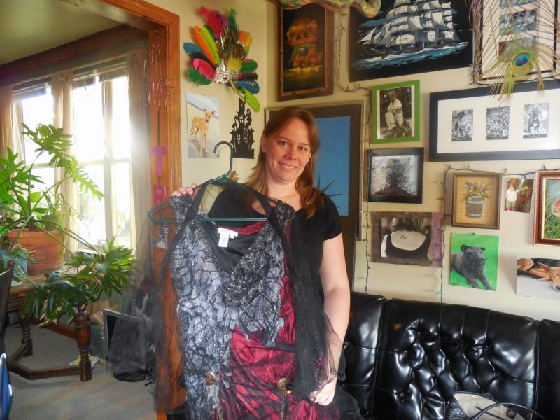 Peige Turner holds up her Zombie Queen dress in her home in Kansas City's Hyde Park neighborhood.