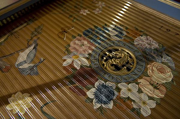 A hand painted kingfisher adorns the French single-manual harpsichord built in 1979 by Thomas Pixton. The group has nicknamed the harpsichord 'Tom' for the instrument maker who built it.