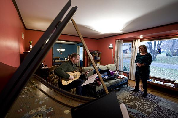 Framed by the lid of the harpsichord, Beau Bledsoe and soprano Rebecca Lloyd rehearse together.