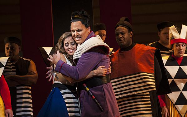 Meeting at last, Lauren Snouffer, as Pamina, and Shawn Mathey, as Tamino, embrace and proclaim their love for each other.