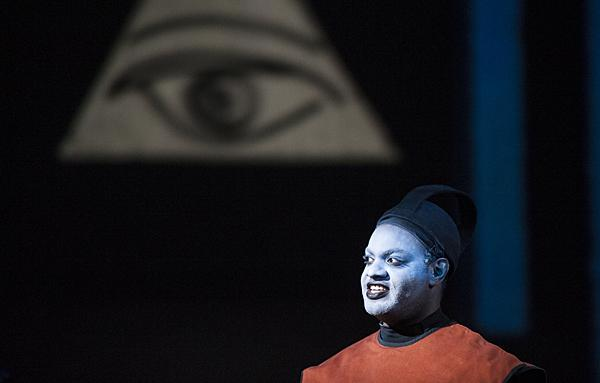 Dominic Johnson as the first priest warns Tamino and Papageno of the trials of initiation that await them.