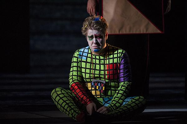 Separated from his companion Tamino, Daniel Belcher, as Papageno, is frustrated by the trials of initiation.