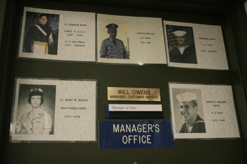 A group of photos decorate the manager's office door at the Brookridge Post Office.