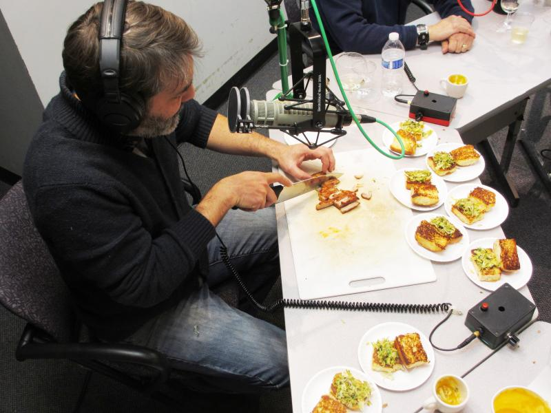 Ted Habiger assembles his pork belly sandwiches with Brussels sprout slaw in the studio.