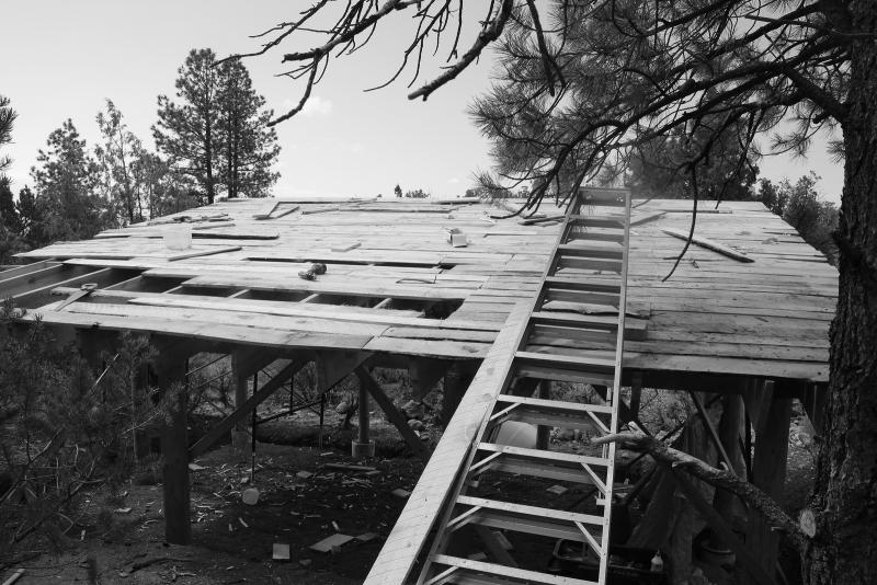 The roof was built with scrap lumber cut to fit and nailed to supporting rafters.