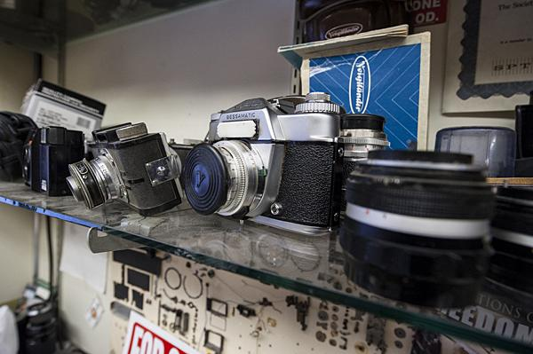 Cameras and lenses decorate a shelf in the shop.