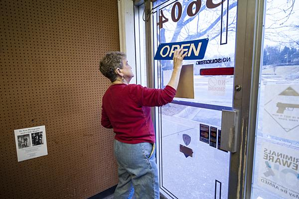Betty turns over the sign, from open to closed, for the final time.