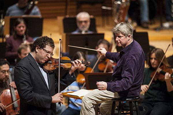 Concertmaster Noah Geller and Music Director Michael Stern bring to the stage Beethoven's Violin Concerto during an open rehearsal in Helzberg Hall at Kauffman Center.