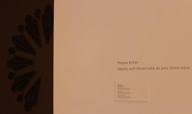 "Visitors are greeted by a sign which reads,""Works will illuminate as you draw near."""