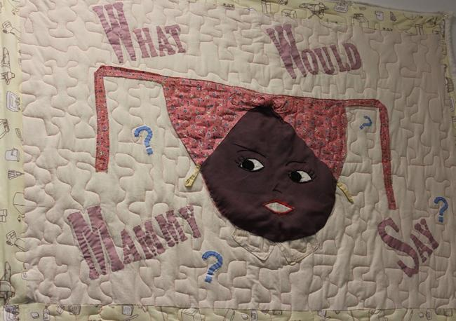 "A close-up of Nancy Dawson's quilt, 'What Would Mammy Say?' (2013). Dawson describes herself a ""social change quilter."""