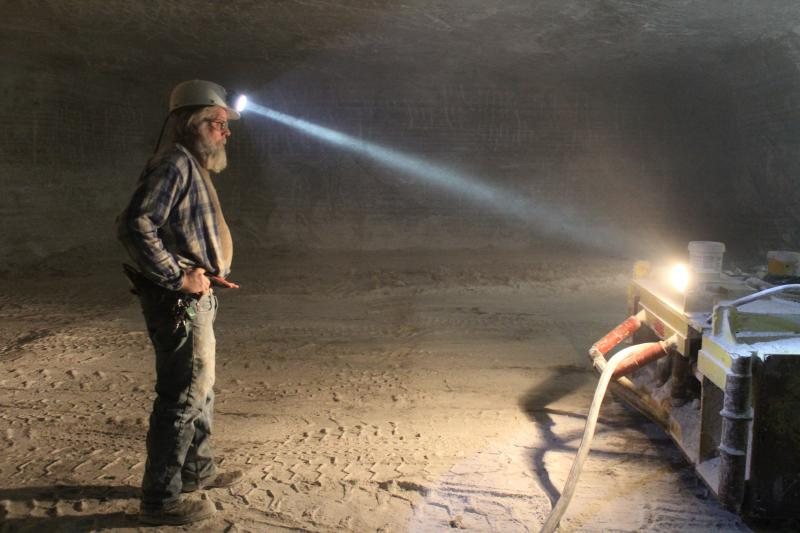 Salt Miner Lewis Lavy rests for a moment before drilling another wall of rock salt.   The Hutchinson Salt Mine has been working 24/7 for months.