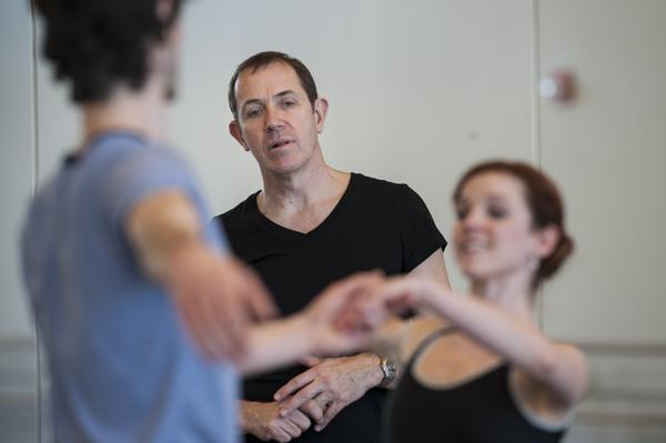 Choreographer Michael Pink (center) observes Geoffrey Kropp (as Arthur) and Laura Hunt  (as Lucy) as they glide by working on a scene from 'Dracula' at the Todd Bolender Center for Dance and Creativity.