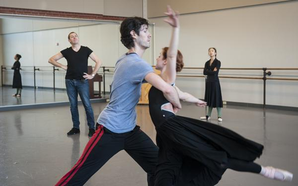 Under the watchful gaze of Pink, Kropp and Hunt rehearse in a practice room as dancer Sarah Chun looks on.