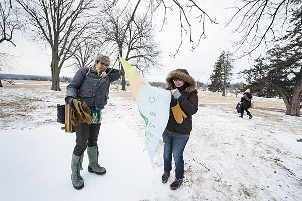 Bingaman (from left) and Melissa Lenos raise the KC PAC flag as the other artists head out to find a suitable landscape.