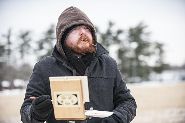 Frost coats Bell's beard as he works in a snowy field.
