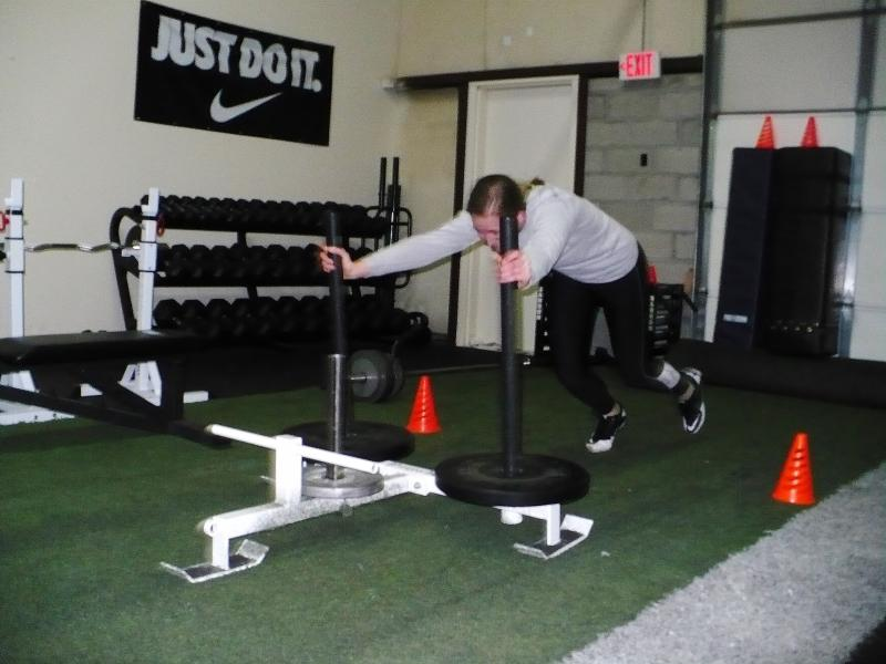 Part of training includes pushing a 200-pound prowler, similar to those you see professional football players use  in training.