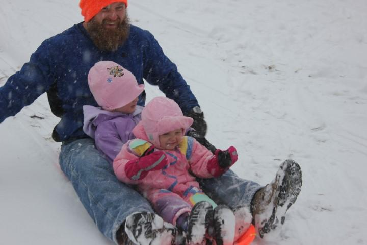 KCUR systems administrator, Chris Prewitt, took to the sledding hill with his daughters
