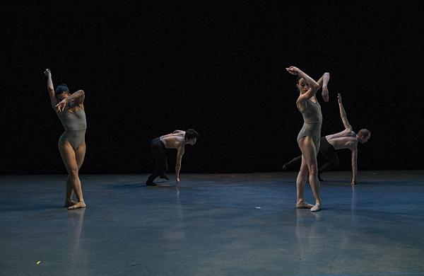 Asymmetric patterns emerge as the dancers move together onstage.
