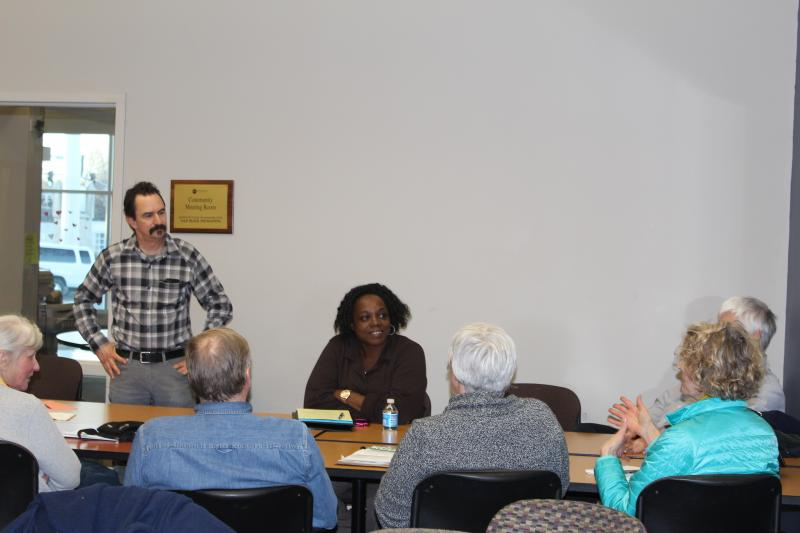 Frank Morris, KCUR reporter, left, leads a discussion with members of the 49/63 neighborhood during a March community listening session at Rockhurst University