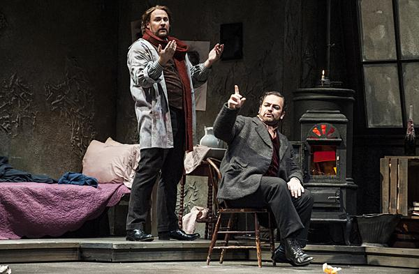 On a  chilly Christmas Eve in 1890, Lucas Meachem, as Marcello, and  Rodolfo (Berrugi) burn acts from a play to keep warm in their cold garret apartment.