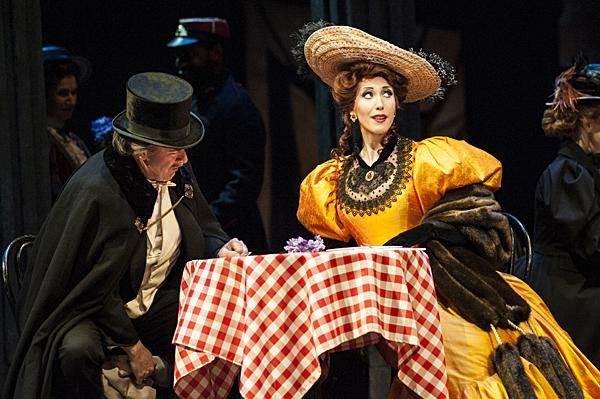Rod Nelman, as Alcindora, and Ellie Dehn, as Musetta, sit down together at the cafe, but it is clear that Musetta only has eyes for Marcello.
