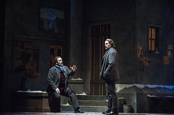 Rodolfo (Berrugi) confesses to Marcello (Meachem) that it is Mimì's fatal illness that is driving them apart.