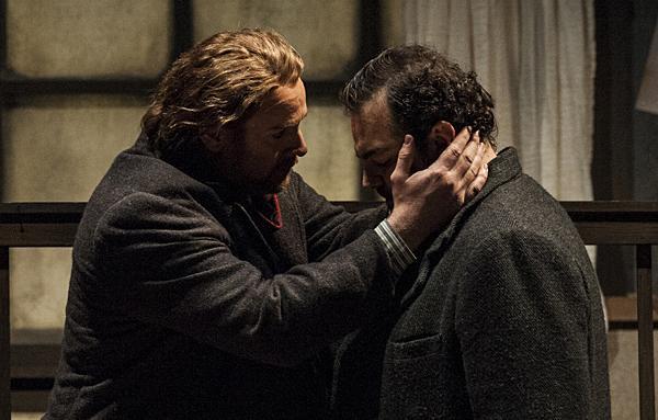 Marcello (Meachem) comforts Rodolfo (Berrugi) as Mimì slips away.