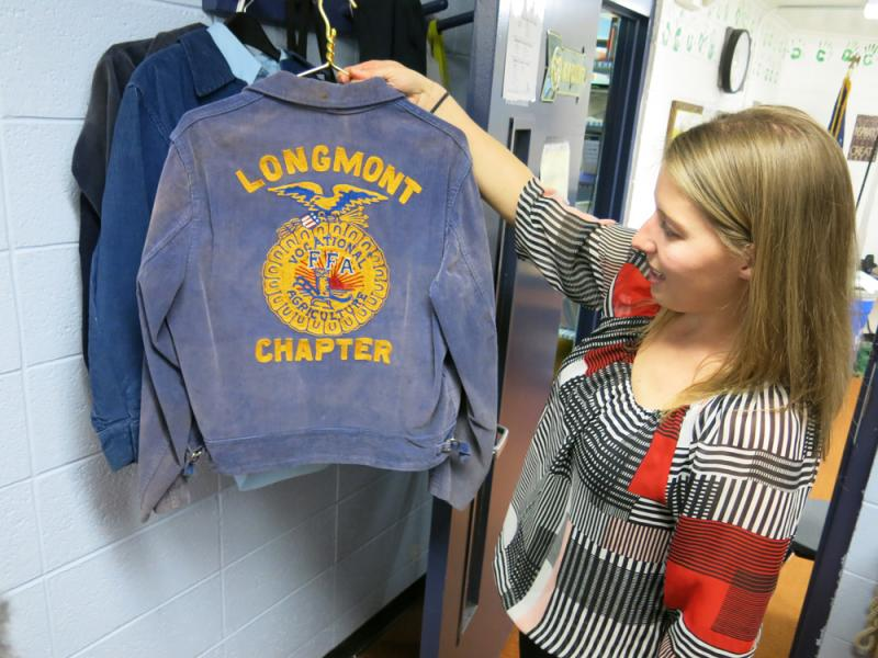 St. Vrain Valley FFA adviser Lauren Hart holds up a jacket from the district's first FFA chapter, founded in the early 1930s when Longmont, Colo. served as an agricultural community.