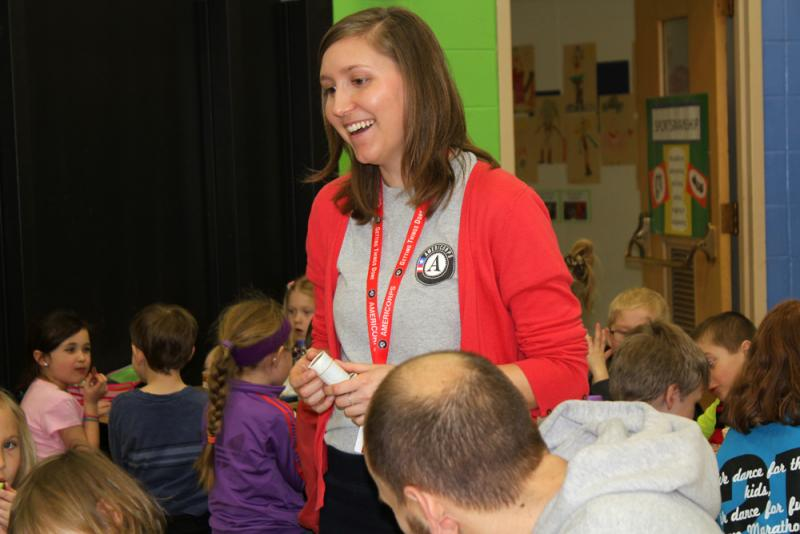 AmeriCorps member Megan Woodward works with students at John Cline Elementary School in Decorah, Iowa.