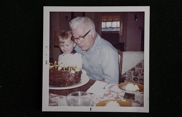Julie and her grandfather Charles Denesha blowing out the candles in 1972.