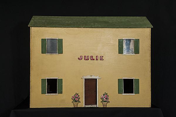 A two-story dollhouse built in the early 1970s by Charles Denesha.