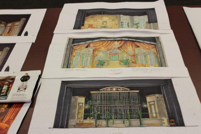 A close-up of set design images on display.