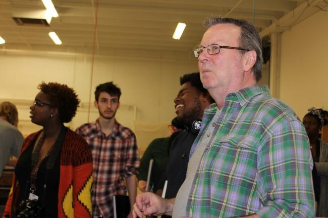 R. Keith Brumley (at right) walks the students through the shop at the Opera Center.