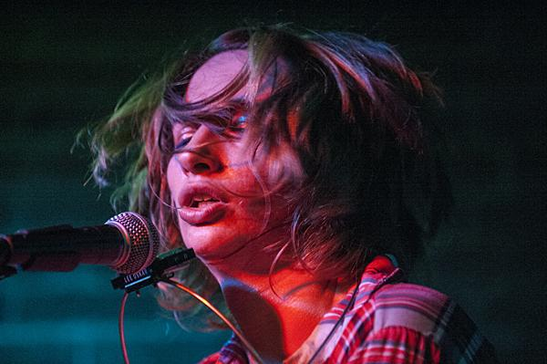 Hair flying, Molly Gene, of One Whoaman Band, performs Thursday night at  Westport Saloon.