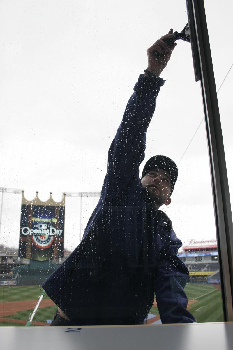 A worker cleans the windows of Kauffman Stadium's Diamond Club.
