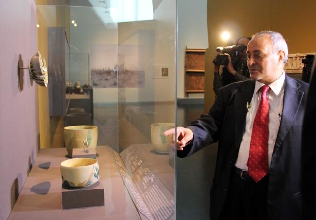 Ali al-Ghabban, with the Saudi tourism commission, points to some of the decorated vessels.
