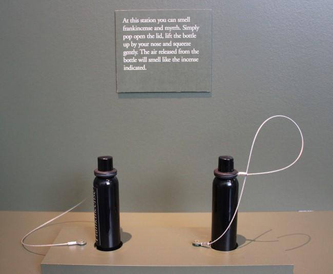 The exhibition has interactive stations, including this opportunity to smell incense.